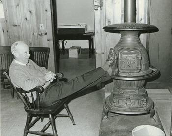 Dr. Chester Ellsworth Cross, with feet on woodstove