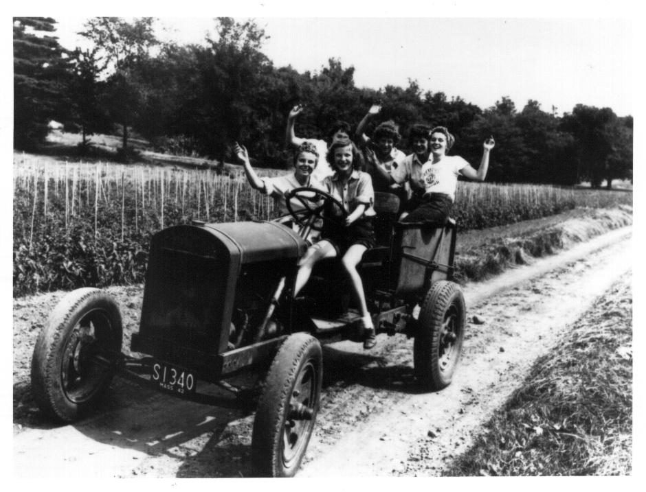 Women Students on Farm Vehicle