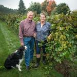 Joyce and Phil Wiley and their dog Sky at UMass Cold Spring Orchards