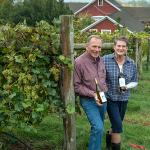 Joyce and Phil Wiley with their wine at UMass Cold Spring Orchards
