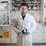 Adam Salhaney ('19) worked on project for rapid bacteria detection in food science laboratory. Photo: John Solem