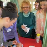 Judy Vollmer instructs students in how to properly diaper an infant