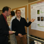 Co-Coordinator Bill Miller attends poster session with presenter Jeff Heithmar