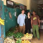 UMass Amherst students and Cuban worker in open air market