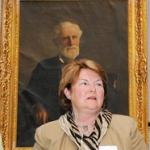 Kay Stockbridge, family historian with portrait of Levi Stockbridge