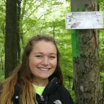 Tara McElhinney ('19) posyts interprestive signs throughout Abbey Brook,Springfield