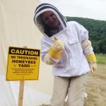 Kristen Michaud dons beekeepers gear for her research on disease transission