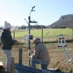 Elizabeth Garafalo and Jon Clements install weather station in South Deerfield