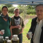 Jennie Bergeron, Aaron Drysdale and Director Arthur Kinney enjoy herb tea from the garden