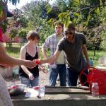 GardenShare student farmer, Jake Harness, makes fresh apple cider