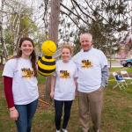 Shaun Fitzgerald, UMass alum and beekeeper with honor students and bee pinata