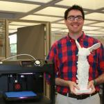 DML Supervisor Dennis Spencer holds 3D model