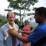 Traditional farewell: red mark on forehead and scarf. The woman in red  sari is an extension agent, a plant and soil scientist