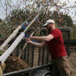 Rick Harper unloads trees