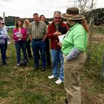 Jon Clements, UMass Extension Educator, educates Tangerini workshop attendees aout orchard care