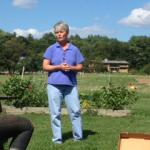 UMass Extension Educator, Sonia Schloeman teaches attendees at Powisett Farm