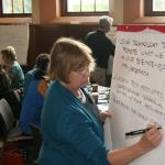 Ellen Weeks and Will Snyder document observations at table discussions