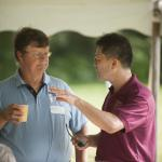 Turf Field Day 2015: Dr. Geunhwa Jung talks turf with an attendee.