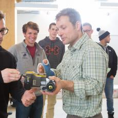 Ben Weil shows students how to operate infrared camera to check for thermal leaks