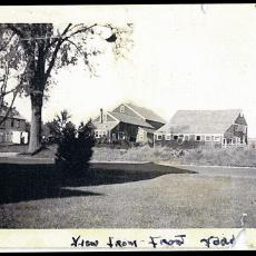 Robert C. Adams farm buildings viewed from North Pleasant Street, late 1940's.