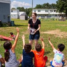 Amanda McCabe-Hernandez teaches youth different exercises