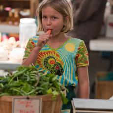 Amherst Farmers' Market child enjoys fresh carrot