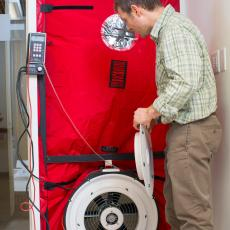 Ben Weil demonstrates proper use of blower door testing