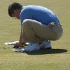 Dr. Geunhwa Jung takes soil samples on organic golf course