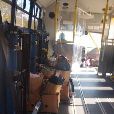 Seats removed from RTA van to accommodate bags of food for delivery