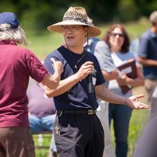 Geunhwa Jung informs visitors about turfgrass management strategies