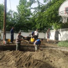 Residents of Hector Reyes House cover contamintated soil with healthy soil