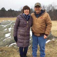 Michelle Conte Webb and Harry Webb on their land in Hardwick