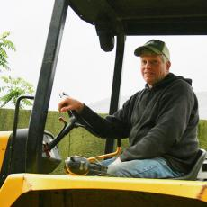 Keith Lilly helps to manage cattle and compost