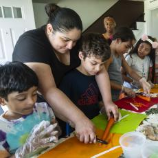 Adults and youth work together to prepare new recipes