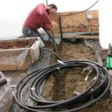 Installing plumbing for corn boiler at Atlas Farm