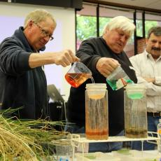 Participants add water to soil
