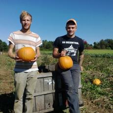 UMass students Neev Blume and Cole Lanier offer tour of pumpkin patch at SFE