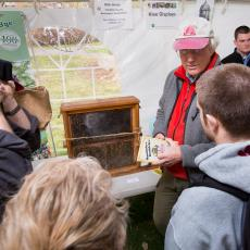 Rick Intres, Beekeeper, Ashfield displays live observation hive