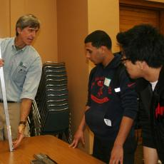 Al Averill shows students soil sampling techniques