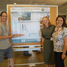 Brian Yellen, Julia Casey and Professor Christine Hatch with poster on glacial history