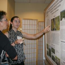 Emily Lozier, senior,  points out reserach data to Paige Warren