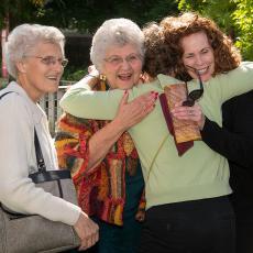 Joyous reunion for former staff