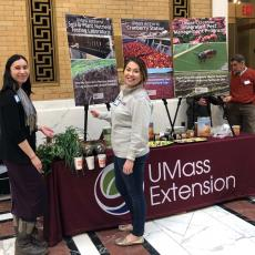 Extension Climate Adaptation Coordinator Melissa Ocana and Samantha Corcoran-Glaze, doctoral student in plant biology, at the Extension booth at Ag Day.