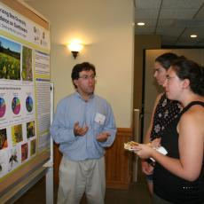 Justin Roch explains methods for collecting data on bee diversity and abundance on sunflowers
