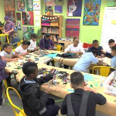 Youth work in Maker Space making lego projects in Springfield