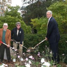 Merle Howes, Pat Vittum and Dean Steve Goodwin bury Time Capsule to be opened 2064