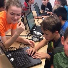 STEM Ambassador with youth working on robotics