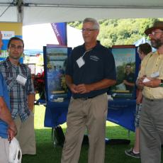 Bill Mitchell and Wes Autio, Stockbridge School of Agriculture, interact with attendees