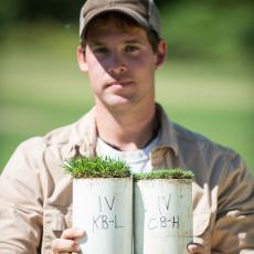 Turf Superintendent James Poro holding soil cores.