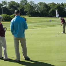 Turf Field Day 2017: Our own Pat Vittum tries her hand at sinking a few putts before the start of the educational program
